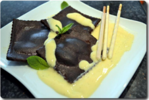 Some different ravioli - chocolate ravioli with cream cheese and aromatic pear sauce